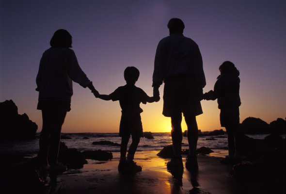 Family-on-a-beach-at-sunset